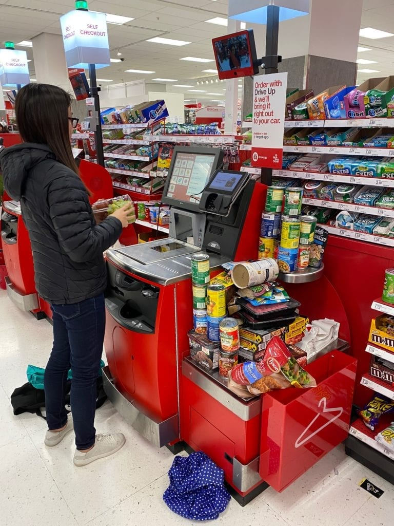 Jennifer Sue stocking up with canned food at Target