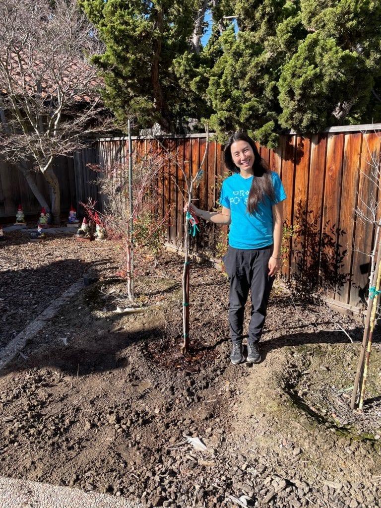Jennifer Sue planting trees